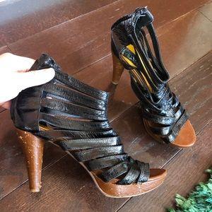 Black leather Jeffrey Campbell cage sandals